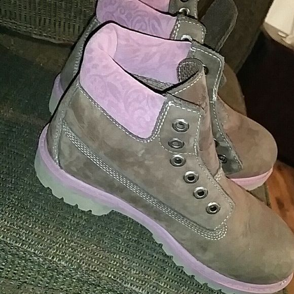 Timberland boots Size 2. Girls. Small mark and the top. Other than that they are like new.  Missing shoe strings Timberland Shoes Winter & Rain Boots
