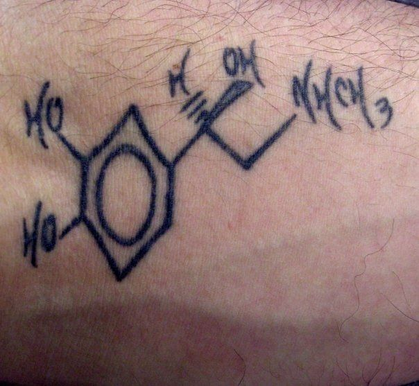 Tattoo of the chemical structure of adrenaline.