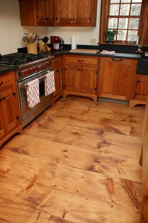 Wide plank pine floors perfect for the colonialinspired kitchen
