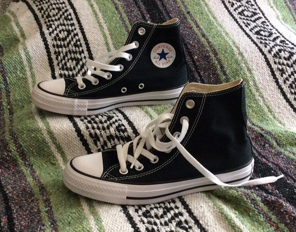 Black converse high top shoes. Woman's