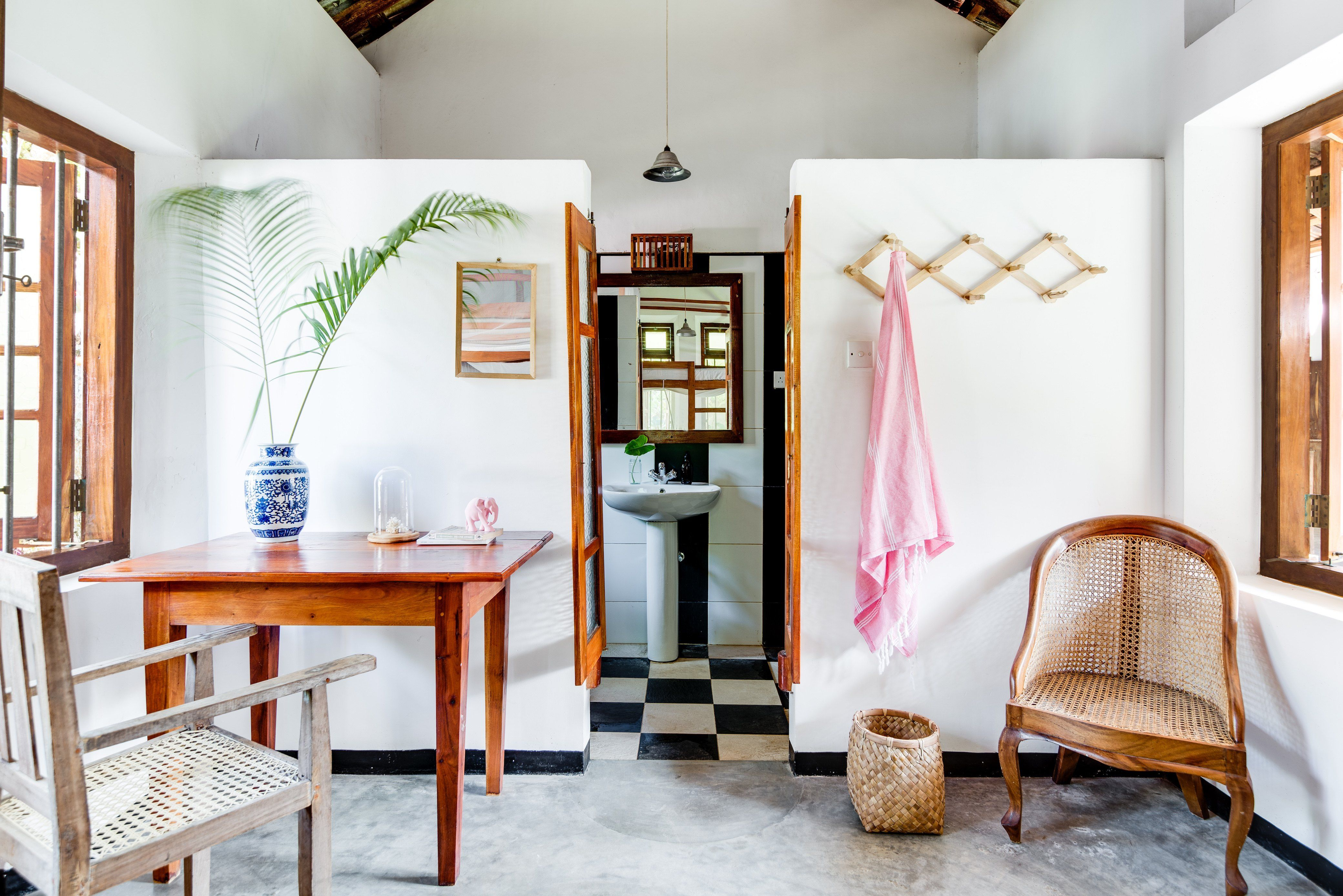 Whitewashed living room in Sri Lanka belonging to surf retreat