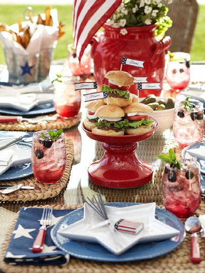 Setting the perfect summer table....The Enchanted Home. Like the star shaped plates and mini slider burgers with flags.