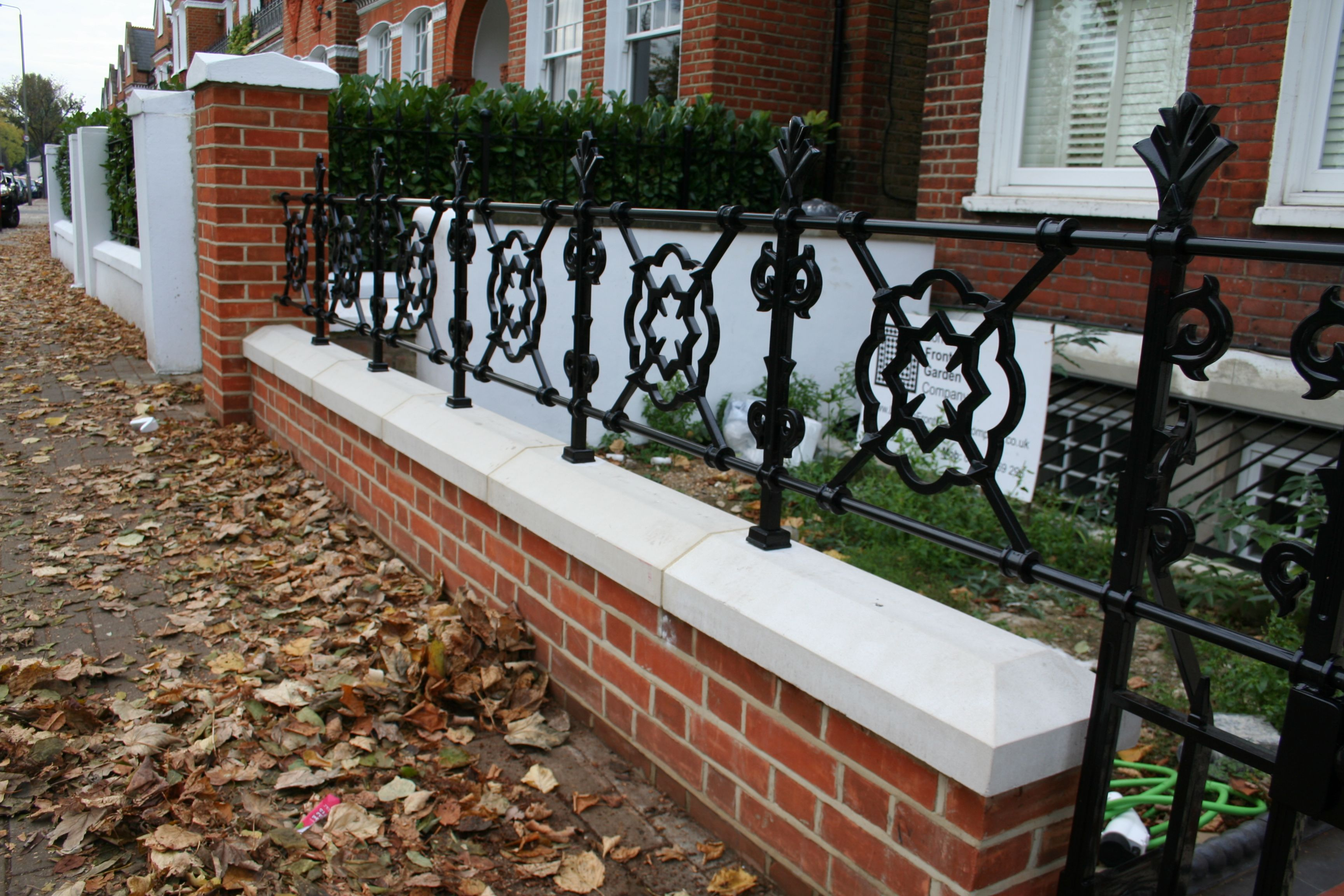 Best Stylish Red Brick Wall And Black Railings In London Front 400 x 300