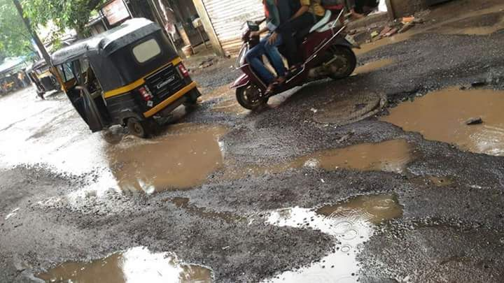 Ulhasnagar Woman Falls Off Bike Due To Pothole Gets Run Over By Truck Bike Get Running Trucks