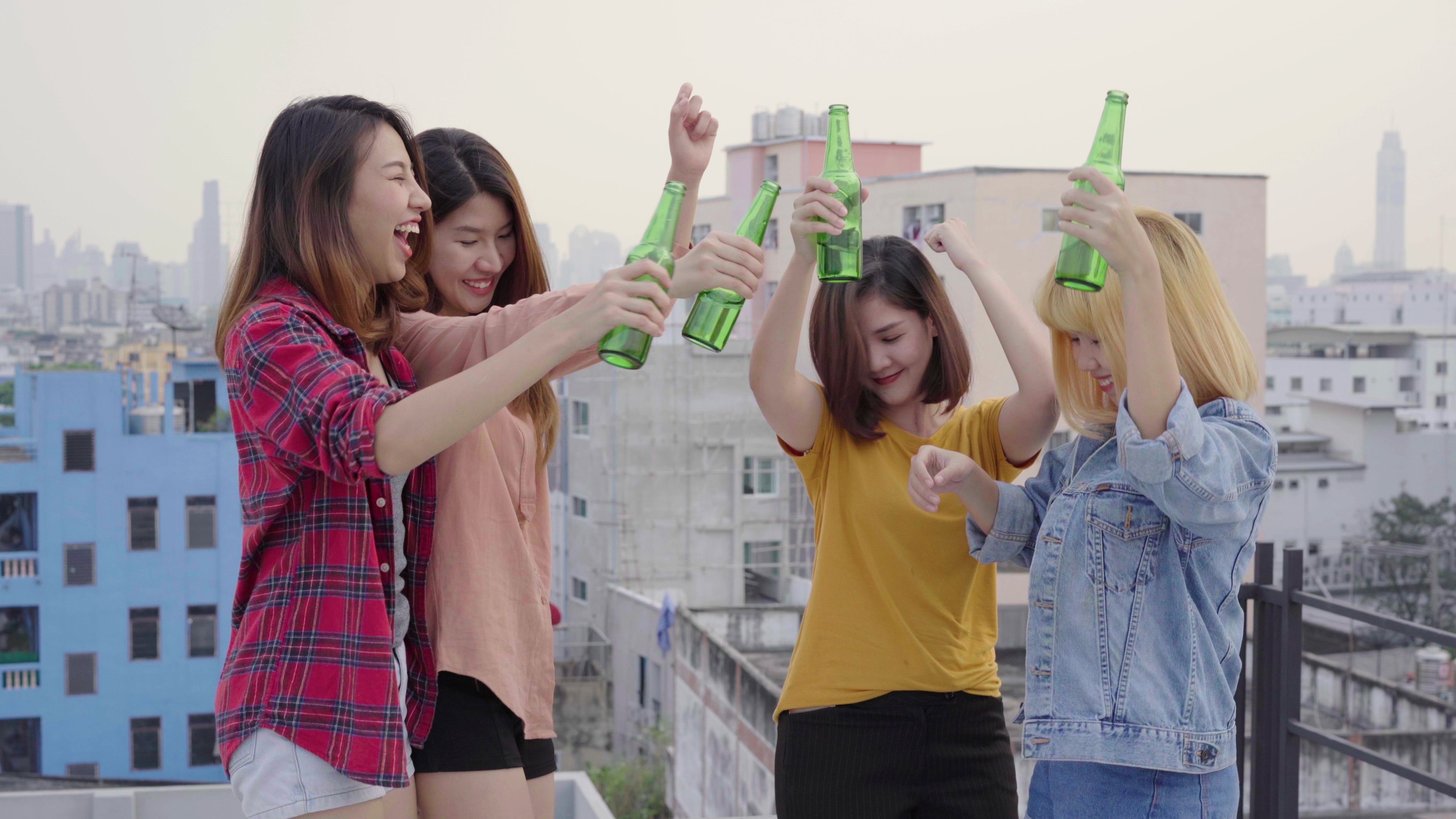 Group of young asian women people dancing and raising
