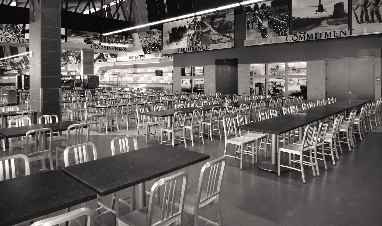 the navy chair used for seating inside a brand new military dining facility designed - Navy Chair