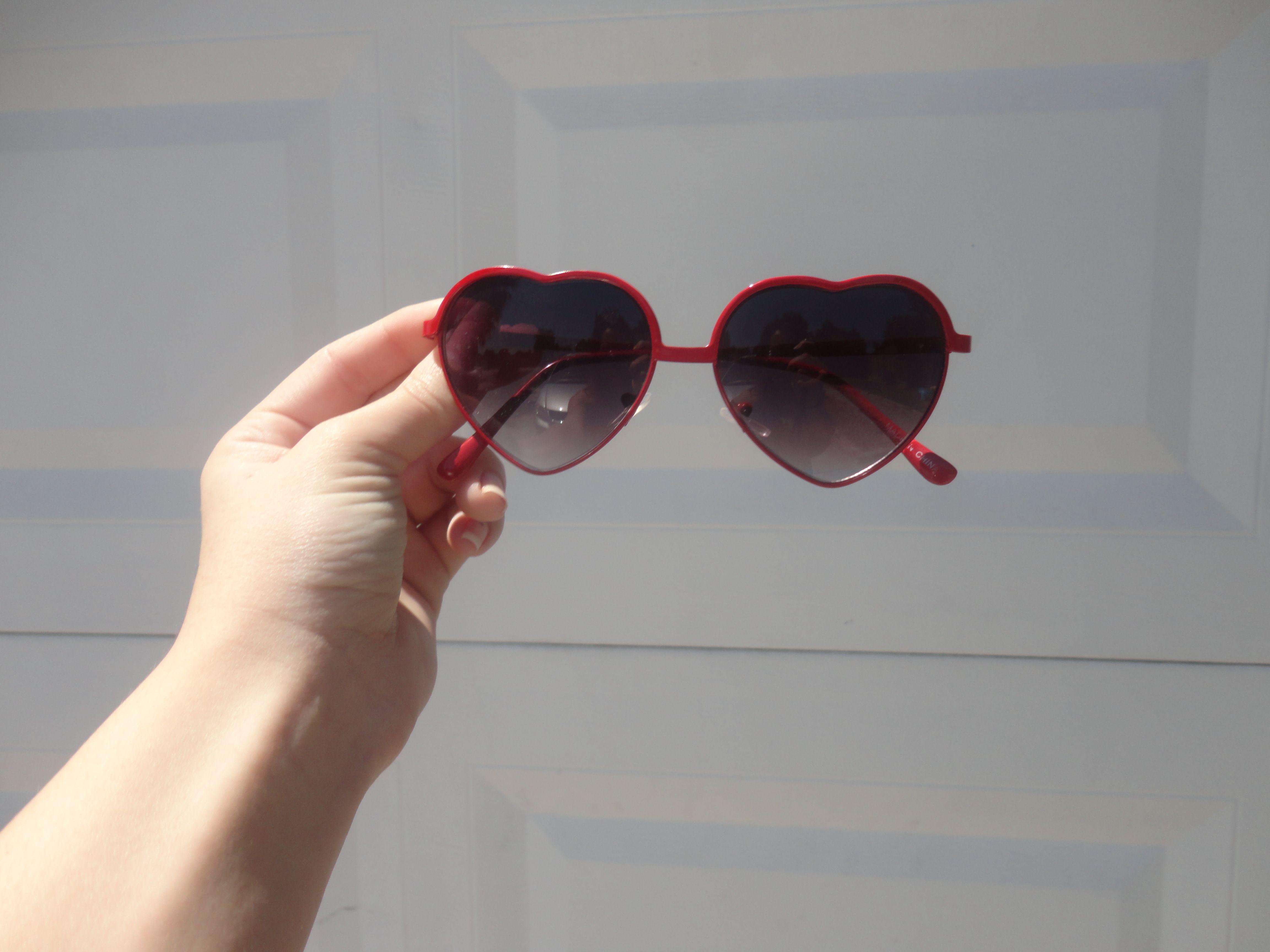 My heart shaped sunglasses are so cute.