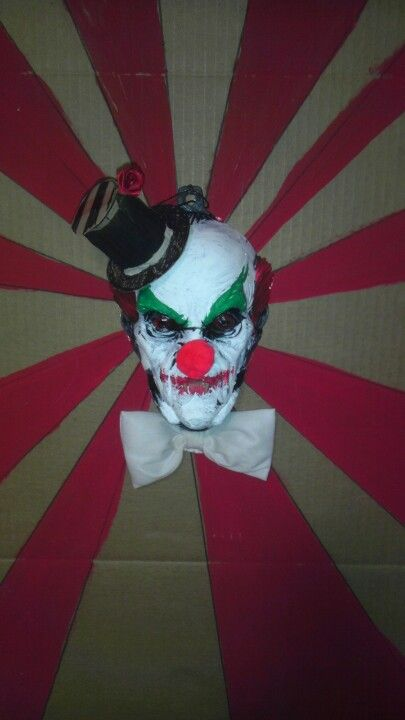My dollar tree Dracula painted face added a nose, hat made from