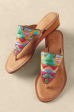 Sao Paulo Sandals A triangle of vivid, neon-bright hand-embroidered geometrics brings a bossa-nova exuberance to these vibrant thongs. Plus they're super comfortable, with a c