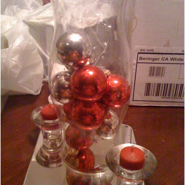 Fun color or old glass christmas balls would be fabulous in a glass centerpiece arrangement... I have a few of the 1960's teal, pink, red, lime green, bright blue, gold, and silver I put in the brandy sniffer