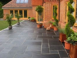 Slate Paving Against Red Brick Extension