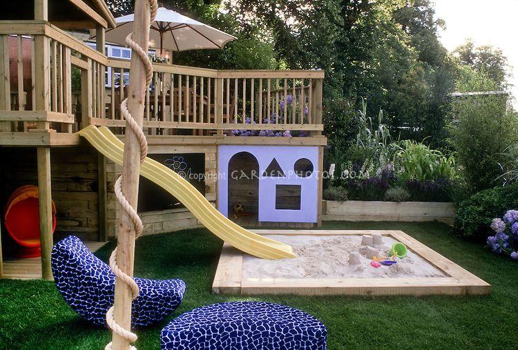 Sandbox In Backyard Landscape For Children Plant Flower Stock