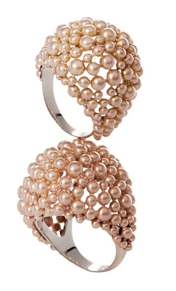 baby pearls lushly surround these rings