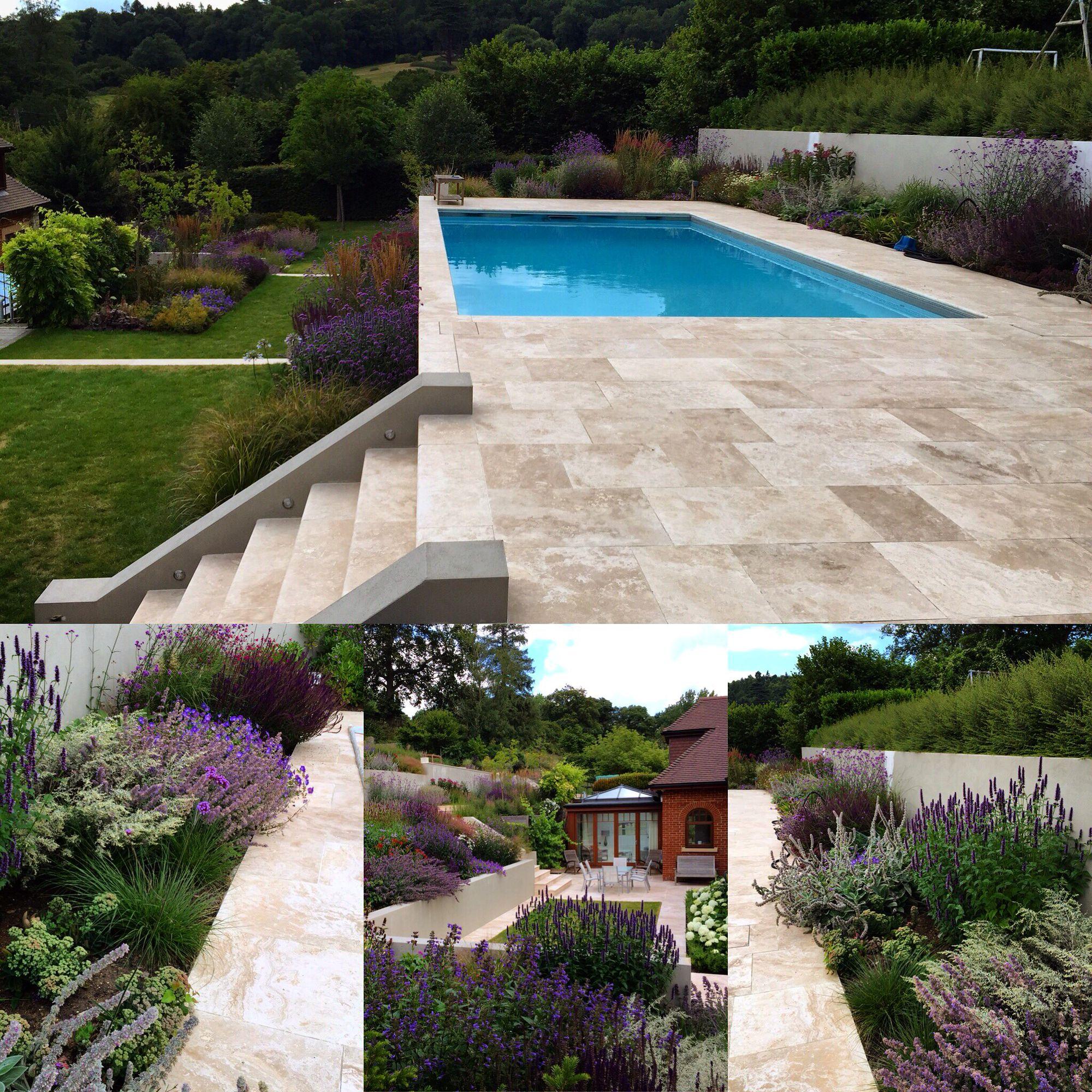 Love the upperlevel pool on this hillside lot backyard