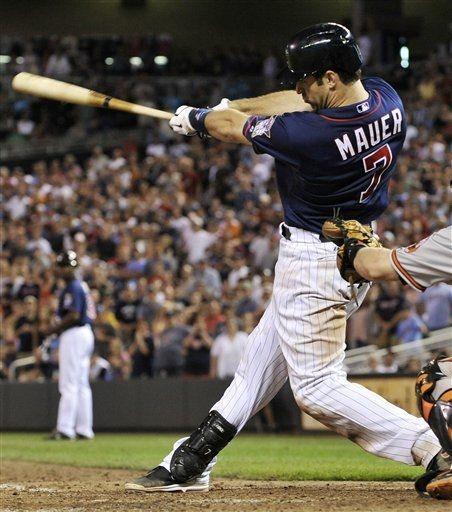 Minnesota Twins' Joe Mauer hits an RBI single off Baltimore Orioles pitcher Pedro Strop in the eighth inning of a baseball game, Tuesday, July 17, 2012, in Minneapolis. Mauer went 3-for-4 as the Twins won 6-4.
