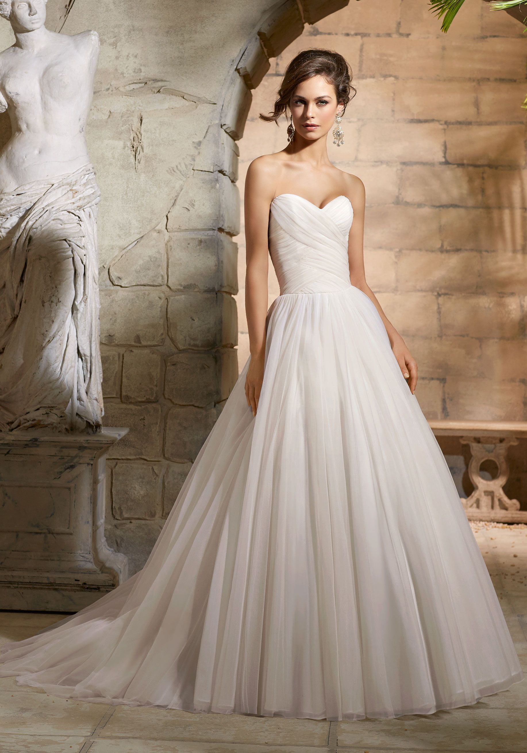 A blank canvas of simplicity, this unadorned A line Bridal Dress ...