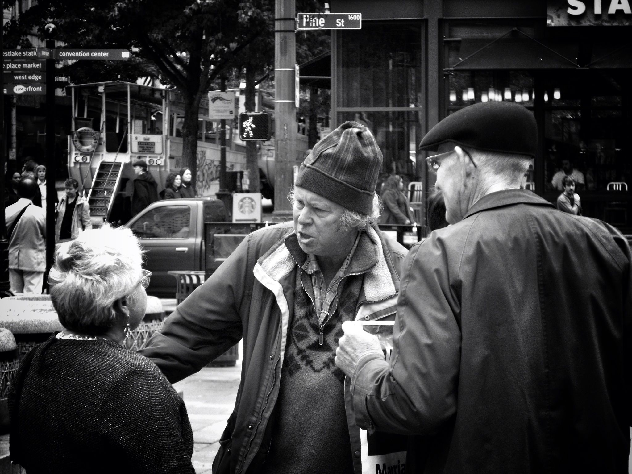 Arguing about Gay marriage at Westlake in Seattle. The woman in the glasses was pro Equality and the two men were not.