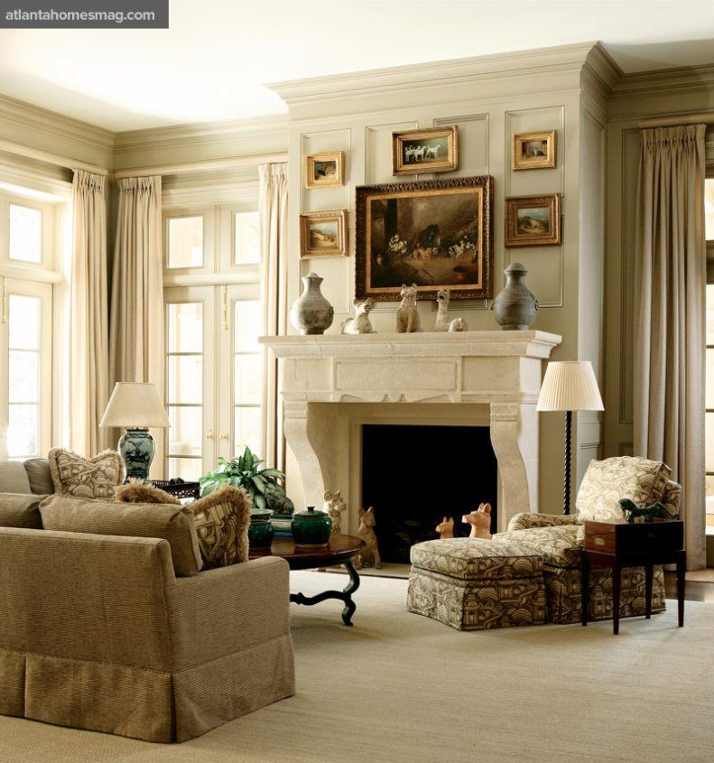 Love the raised, decorative moldings, colour scheme  fireplace
