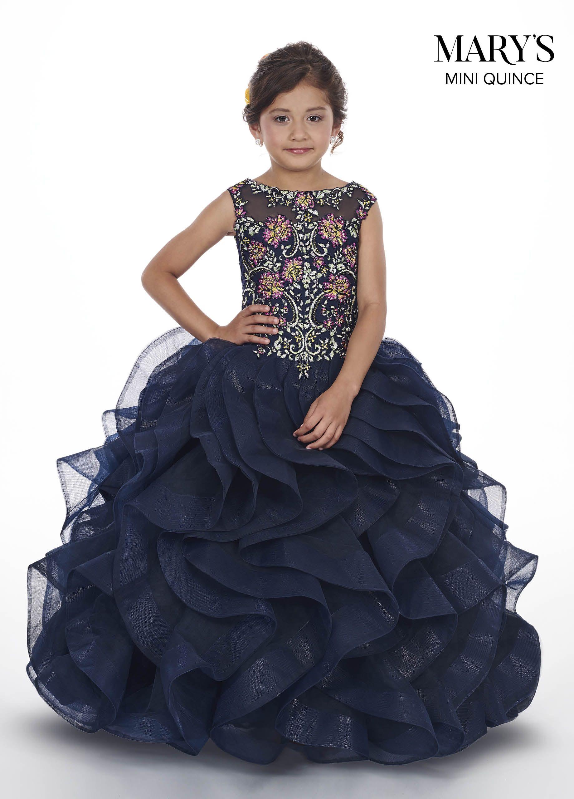 53b443884b5 Floor length tulle ball gown with a sheer yoke