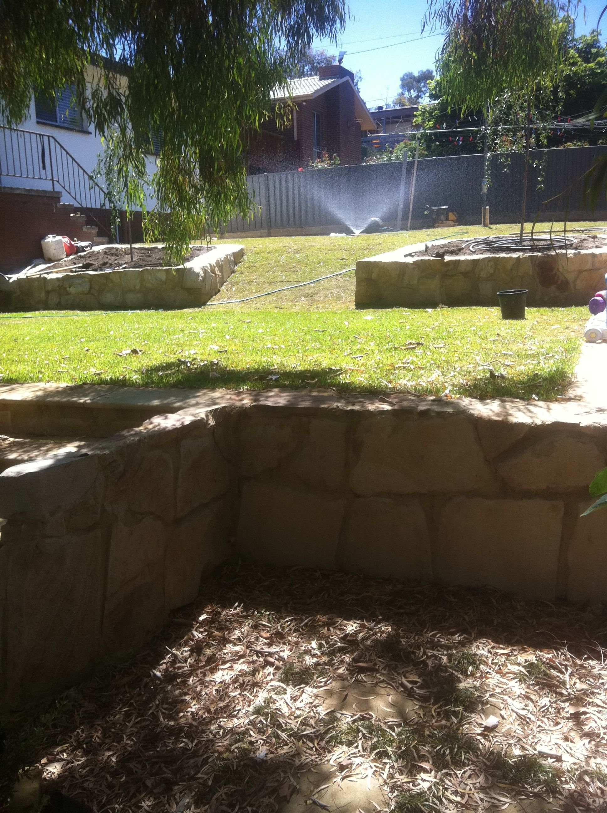 Concrete block raised garden beds. Sandstone retaining walls ...