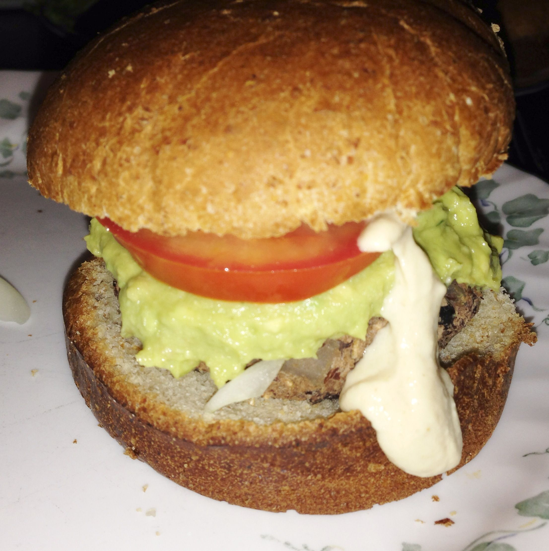 Black bean burgers with avocado hummus tahini sauce