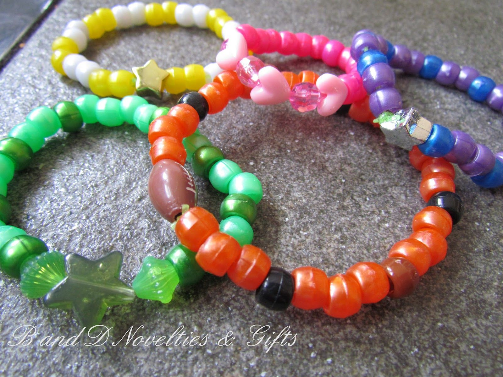 Beaded bracelets with charms purple pink green