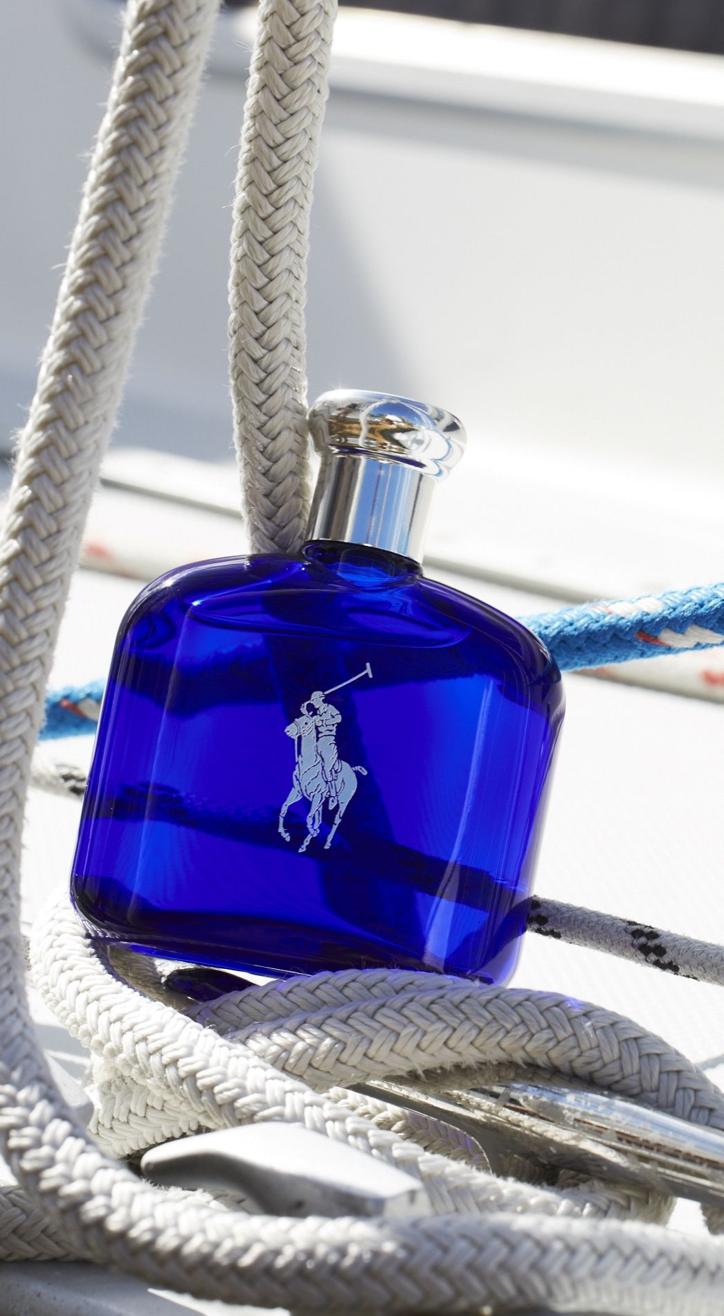 Sail away with Polo Blue fragrance from Ralph Lauren. The scent features a  refreshing blend of melon de Cavaillon, basil verbena and washed suede. 5107161535