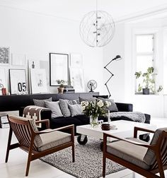 Scandinavian Lounge With Black Leather Sofa Google Search Scandinavian Design Living Room Living Room Scandinavian Black And White Living Room