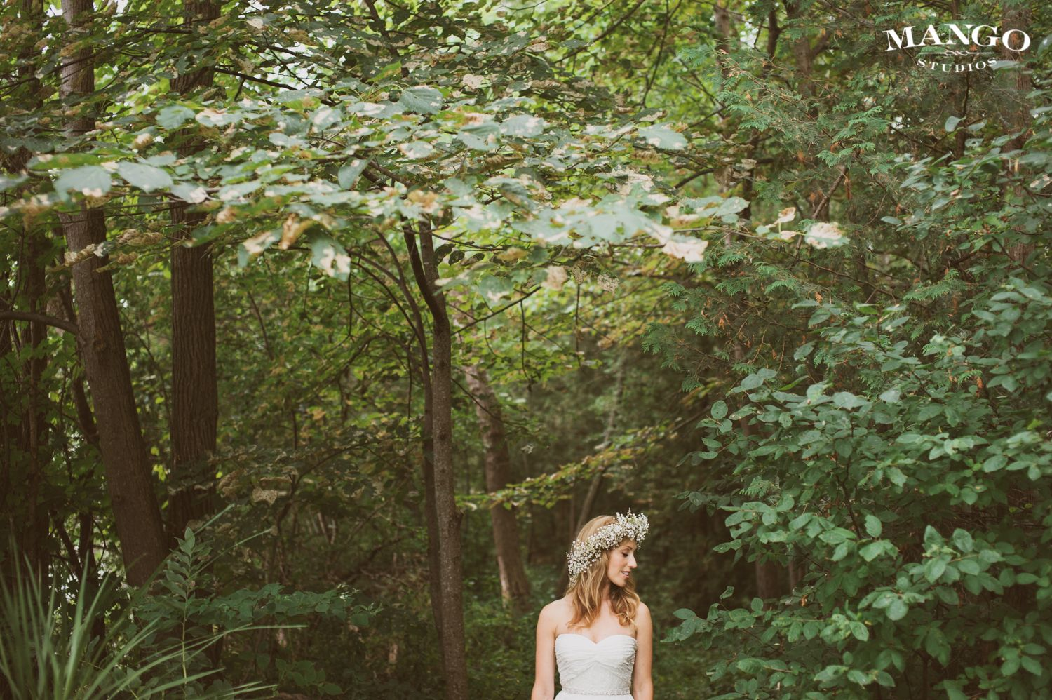A Match For Nature #bride #nature #outdoors #green #weddings #white #flowers #dress #flowercrown #glowing #ideas #weddinginspiration #mangostudios Photography by Mango Studios