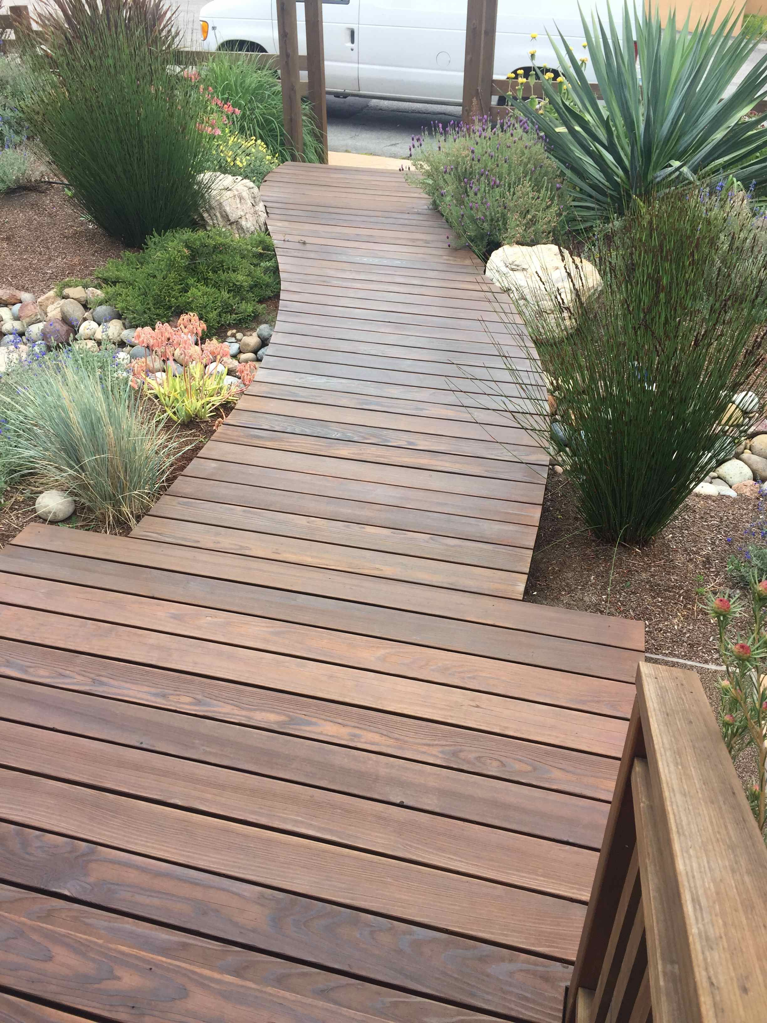 Walkway built out of Ipe wood. Screwless. Surrounded by ...