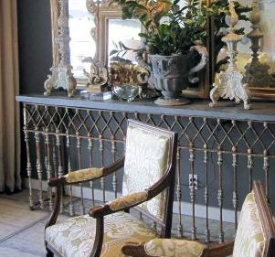 Wrought iron console table idea. This would be placed against the mirrored wall, opposite the french doors. Two identical lamps, a beautiful vase of flowers, framed photographs and other mementos would be placed on top.