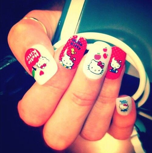 Showing love with hello kitty nails.