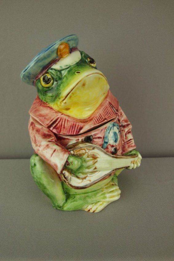 Continental majolica figural humidor in the form of a frog with mandolin, 7 1/2""
