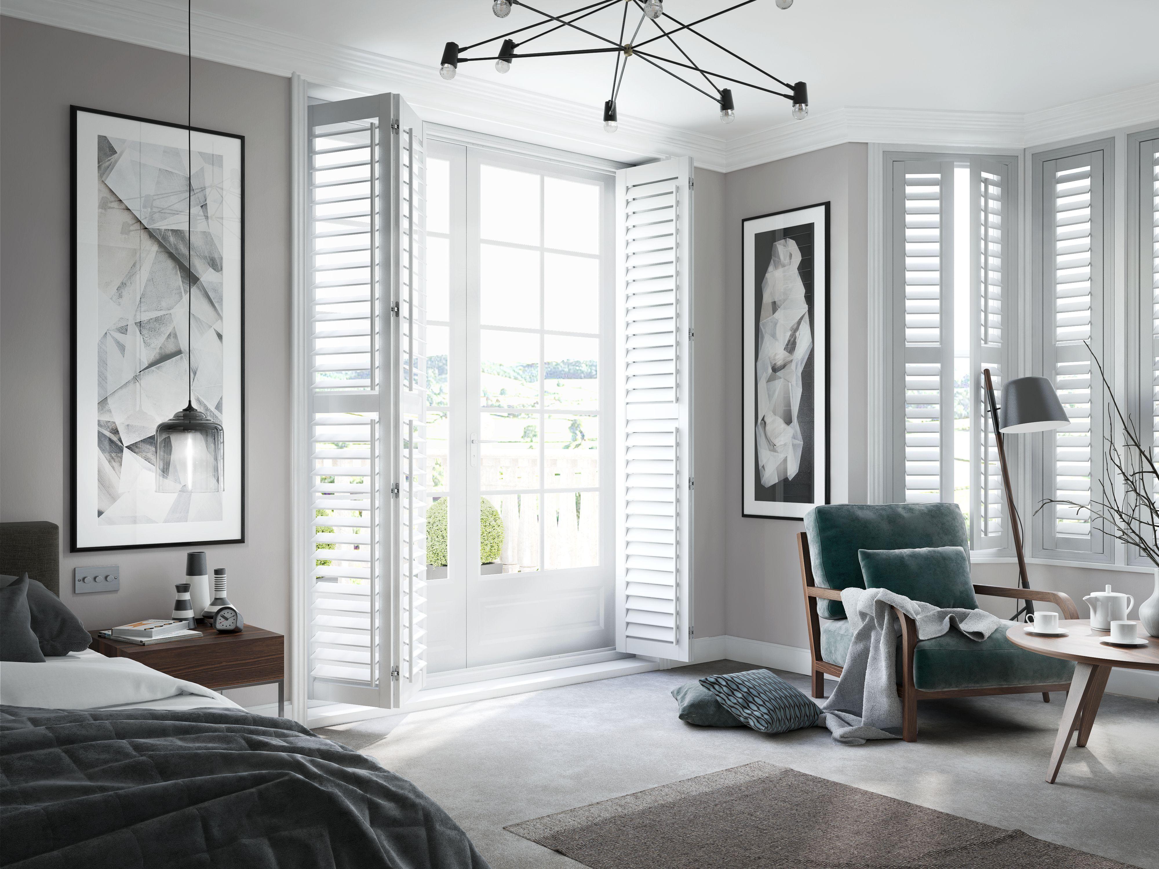 Bedroom with white full length shutters Bedroom shutters