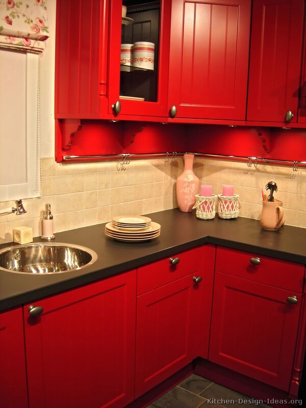 Black cabinets black appliances red walls kitchen for Traditional kitchen appliances