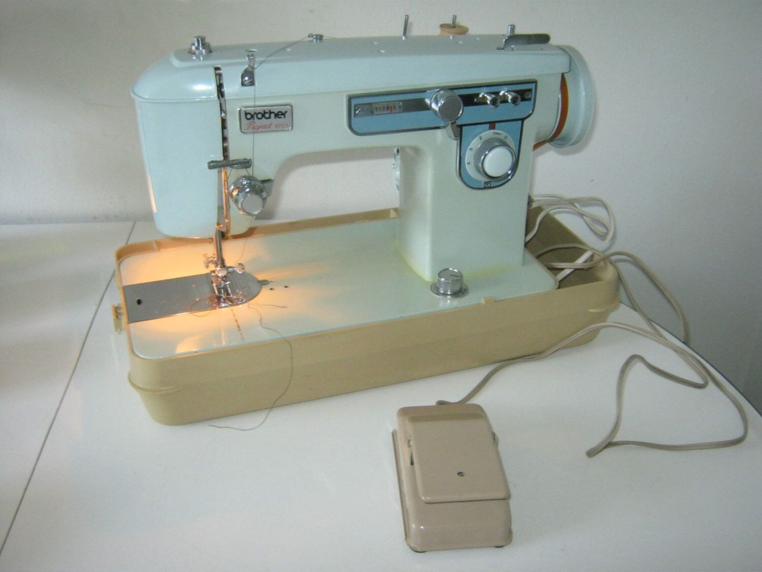 how to clean brother sewing machine