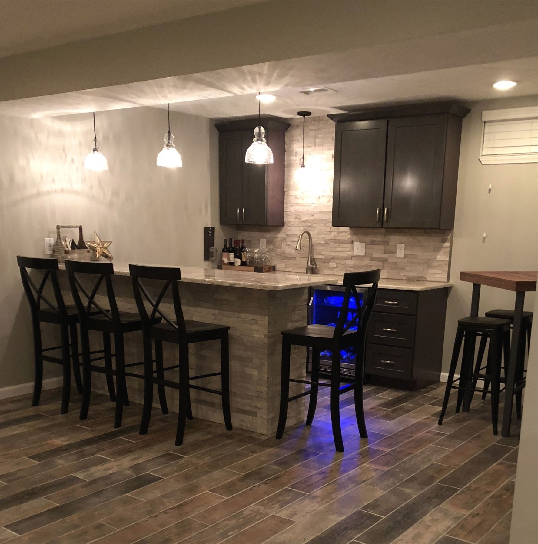 Basement Bar With Stone Veneer Backsplash And Bar Surround. Shaker Style  Cabinets With Pendant Lights And Granite Countertops. #BasementIdeasFinished