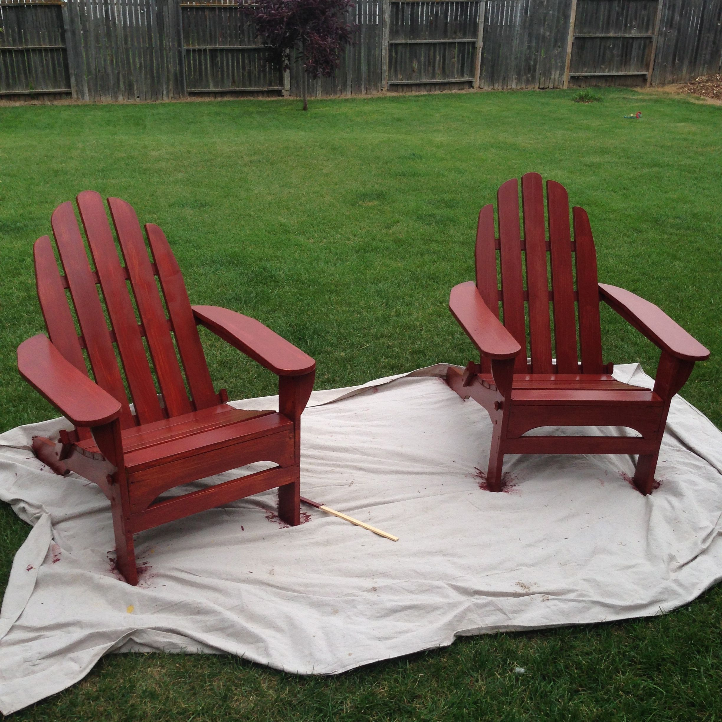 A Quot Pop Quot Of Red Painted Adirondack Chairs Bright Green