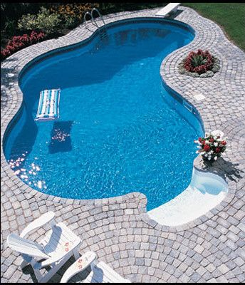 free-form pool with stone paver surround POOL DECKS Pinterest