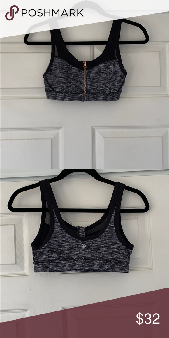 97dcb428556 LULULEMON sports bra Size 4 Mark black and grey LULULEMON sports bra. Gold  zipper in the front. Mesh lining the top. Great condition.
