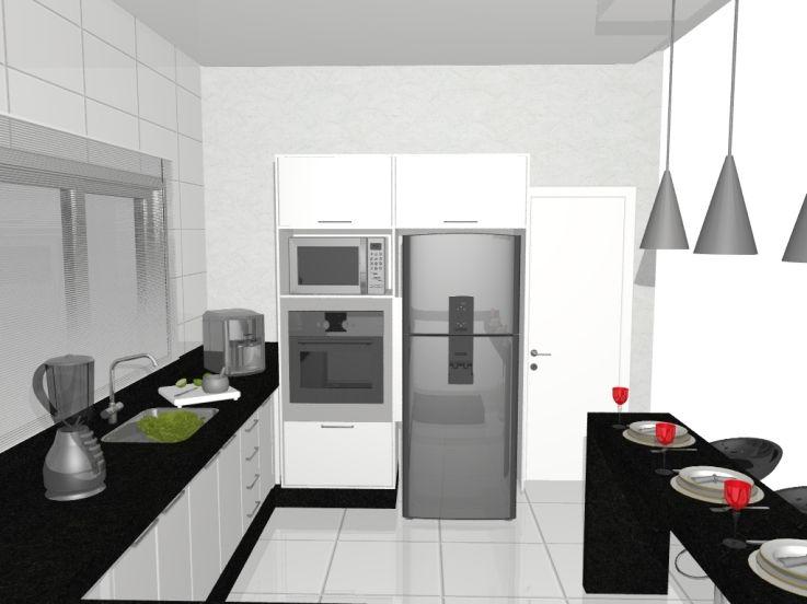 Cozinha integrada com bancada de refeições