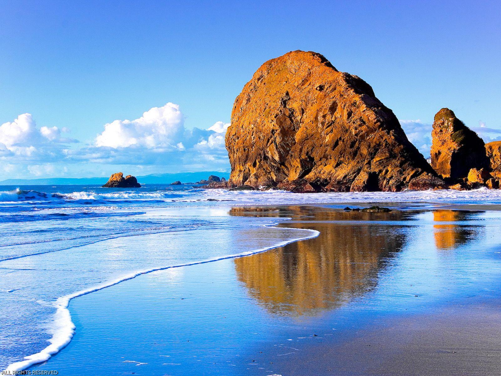 A Huge Rock At The Seaside Mirror In The Water Beautiful Nature Wallpaper Scenery Wallpaper Beautiful Landscape Wallpaper