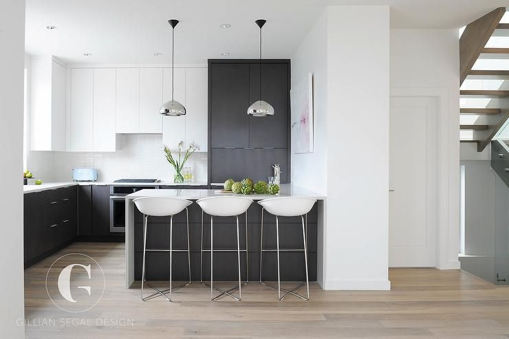 Modern Black And White Kitchen Features White Flat Front Upper Cabinets And Cape Dutch