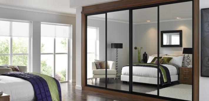 Stylish Bifold Closet Doors Of Espresso Tint Bedroom Ideas