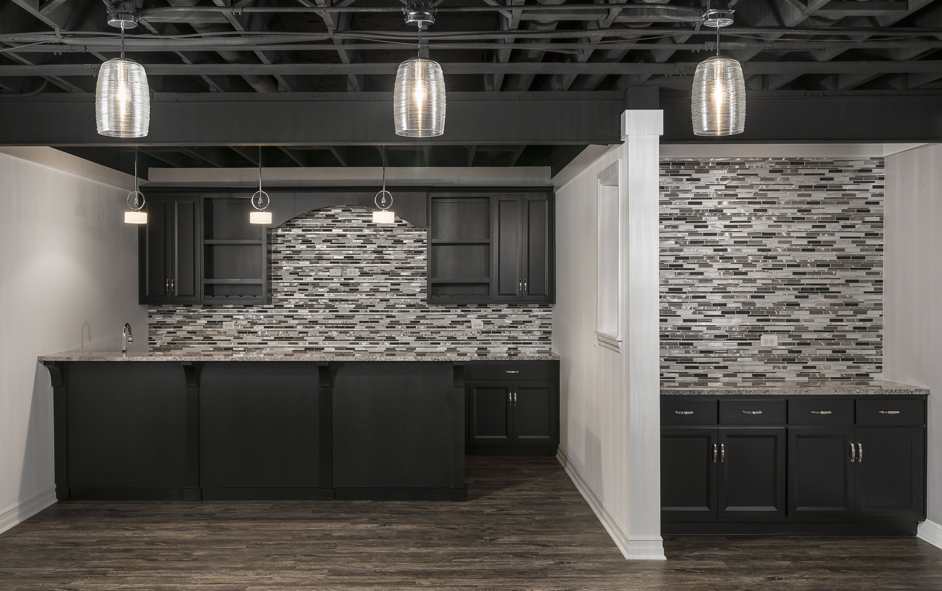 Finished basement with a full wall backsplash dark cabinets a custom homes kings court builders dailygadgetfo Choice Image