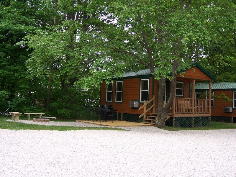 Deluxe Cabins And Lodges Traverse City Koa Traverse City Mi Cabin Outside Living Cabin Rentals
