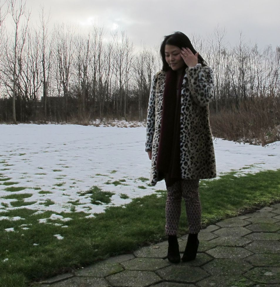 In leopard coat