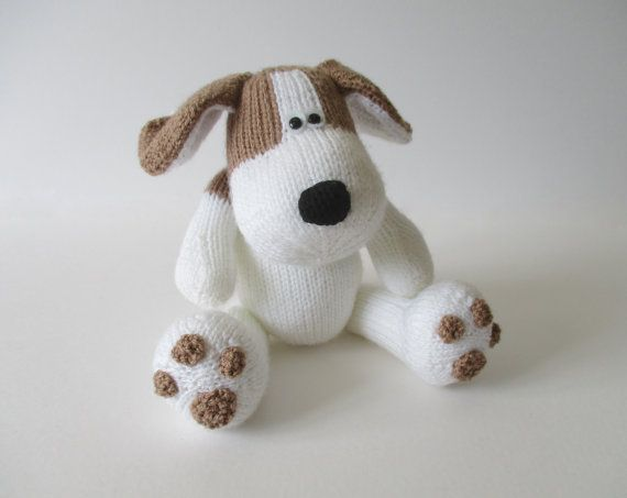SPOT THE PUPPY TOY KNITTING PATTERNS  Spot the Puppy has big feet with brown pawprints, and a spot on his back. PLEASE NOTE: This listing is for the knitting patterns only; this is not a listing for a finished puppy. THE PATTERN INCLUDES: Row numbers for each step so you don't lose your place, instructions for making the puppy, photos, a list of abbreviations and explanation of some techniques, a materials list and recommended yarns. The pattern is 7 pages and written in English. TECHNIQUES…