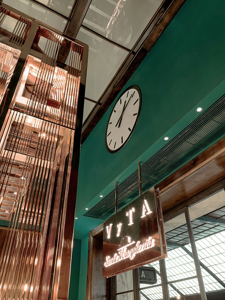 Architect Daniela Colli has transformed a former first-class waiting room in Florence's Santa Maria Novella train station into a copper-tinted boulangerie.