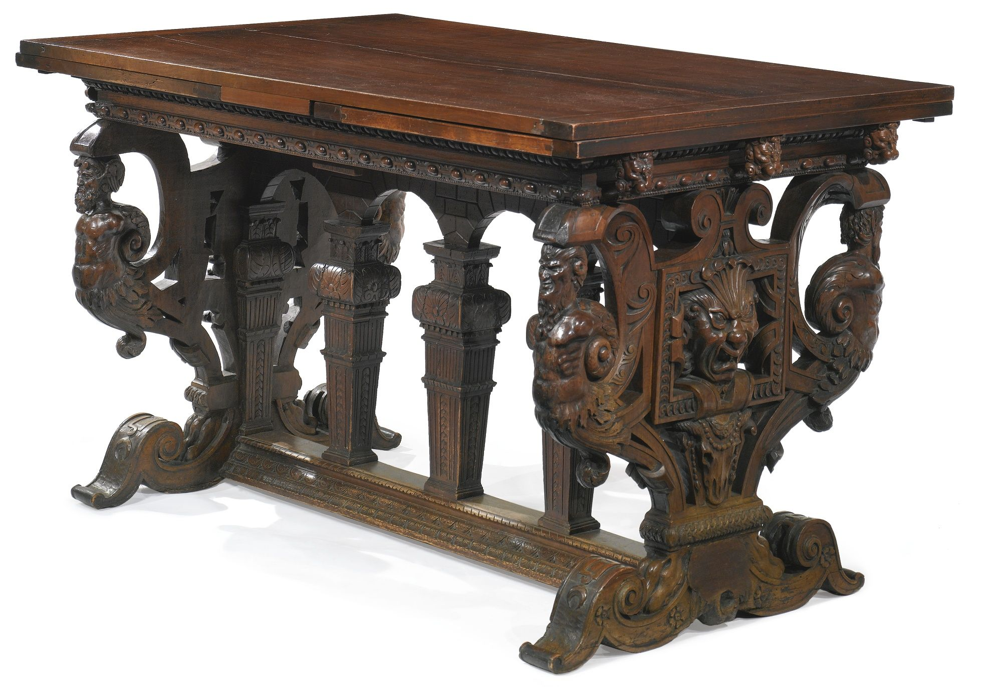 This Italian Renaissance table was carved from walnut wood It is known as a table